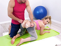 Zoey Monroe loves to exercise and it shows. Here she is doing her floor routine and working up a sweat. Literally. She works out so firm she sweats right thru the goods of her tight, light gray spandex. When her trainer finds her, he fondles his palm agai